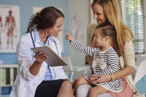 doctor talking to mother and daughter