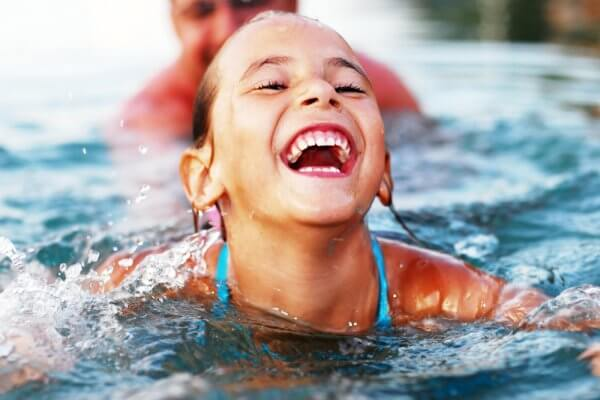 little girl smiling in water